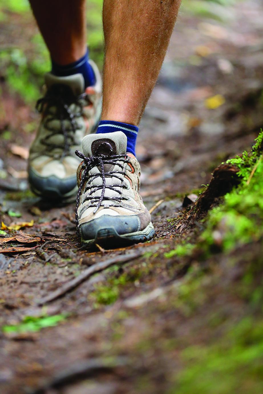 Hiker – hiking shoes closeup from hike walk
